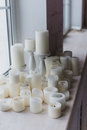 Candles near the window christmas decoration Royalty Free Stock Photo