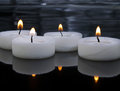 Candles picture of white burning on black background Royalty Free Stock Photos
