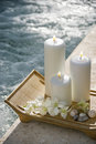 Candles by pool. Stock Photography