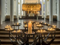 Candles in protestant nikolai church kiel germany Stock Photography