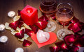 Candles, Red Roses Petals and Wine Royalty Free Stock Photo