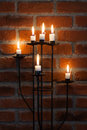 Candles on the red wall Royalty Free Stock Photo