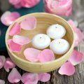 Candles and rose leaves Royalty Free Stock Photo