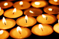 Candles shining in darkness Stock Photo