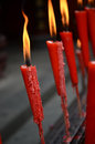Candles in temple red burning a chinese buddhist Stock Images
