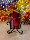 Candlestick from red glass on a metal stand. Royalty Free Stock Photo