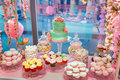 Candy Bar. Delicious sweet buffet with cupcakes and wedding cake. Sweet holiday buffet with marshmallows and other Royalty Free Stock Photo