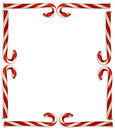 Candy cane border red and white striped canes arranged in on white background Stock Photography