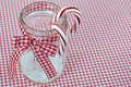 Candy cane in canning jar canes with red and white gingham ribbon Royalty Free Stock Photography
