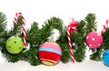 Candy cane and christmas balls Stock Photos