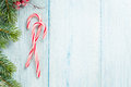 Candy cane and christmas tree on wooden table Royalty Free Stock Photo