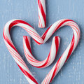 Candy cane heart symbol on blue wood centered square x Royalty Free Stock Photography