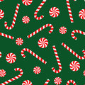 Candy cane and lollipop seamless christmas pattern on green background. Royalty Free Stock Photo
