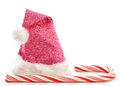 Candy cane and santa hat on white Stock Image