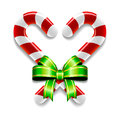 Candy canes and bow a set of two tied together with a ribbon Stock Photos