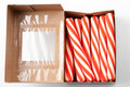 Candy canes in box Stock Photos