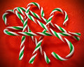 Candy canes a closeup of colorful on a red background Stock Photo