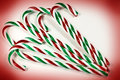 Candy canes a closeup of colorful on a white and red background Stock Photography