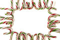 Candy canes forming as a frame Royalty Free Stock Images