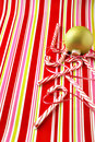 Candy canes and ornament Royalty Free Stock Photography