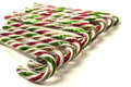 Candy canes in a row on white background Royalty Free Stock Photos
