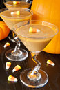Candy corn carmel pudding with corns and pumpkins Royalty Free Stock Photo