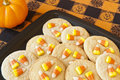 Candy corn cookies halloween with corns on a black plate Stock Photo
