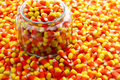 Candy corn glass pumpkin jar filled with Stock Photos