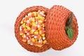 Candy Corn In Pumpkin Basket Royalty Free Stock Photo