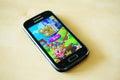 Candy crush saga game on a samsung smartphone Royalty Free Stock Image