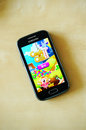 Candy crush saga game on a samsung smartphone Royalty Free Stock Image