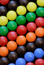 Candy in diagonal rows on black Royalty Free Stock Photos