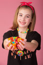 Candy girl cute young with her hands full of Stock Image