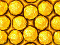 Candy in gold wrappers Royalty Free Stock Image