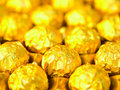 Candy in gold wrappers Royalty Free Stock Photo