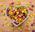 Candy in heart shaped bowl Stock Photo