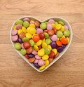 Candy in heart shaped bowl Stock Photography