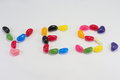 Candy jellybean sign yes written with Stock Photography
