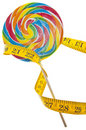 Candy Lolly Pop and Measuring Tape Diet Concept Royalty Free Stock Photography