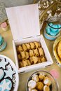 Candy pastry rolls, open box display, wedding candy bar Royalty Free Stock Photo