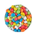 Candy sea pebbles in a white bowl on a white background isolated Royalty Free Stock Image
