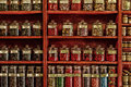 Candy shop red shelf with bottles of candies high iso Royalty Free Stock Photos