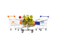 Candy in wrappers in shopping cart on white background. Royalty Free Stock Photo