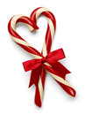 Candycane heart two candy canes in shape with red bow isolated on white background Royalty Free Stock Photography