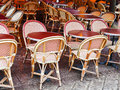 Cane chairs in paris cafe and red table outdoor Royalty Free Stock Photo