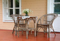 Cane furniture patio chairs and table Royalty Free Stock Photo