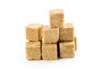 Cane sugar cubes on white background Royalty Free Stock Photos