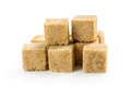 Cane sugar cubes on white background Stock Photography
