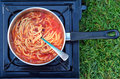 Caned spaghetti cooked outdoors on outdoor gas stove concept photo of food preserved outdoor camping survival surviving travel Stock Image