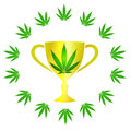 Cannabis cup with leafs big golden Royalty Free Stock Image